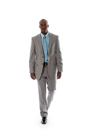Handsome African American man in gray suit with smile walking, isolated