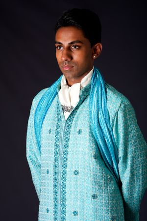 dhoti: Beautiful authentic Indian hindu man in typical ethnic groom attire. Bangali male wearing a light blue agua decorated Dhoti with shawl.