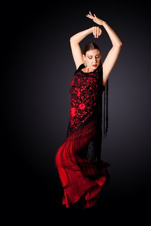 spanish girl: Beautiful female Spanish Flamenco dancer doing a typical line pose, wearing modern attire. Spanish woman dancing Paso Doble in red and black dress clothes, isolated.