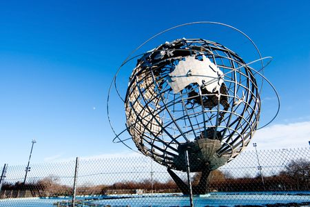 flushing: The Earth World Unisphere globe in Flushing Meadows Corona Park in Queens New York at a bright sunny day with blue skies.