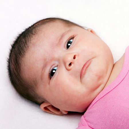 Cute baby with sad expression. Infant with curled lip making faces. Stockfoto