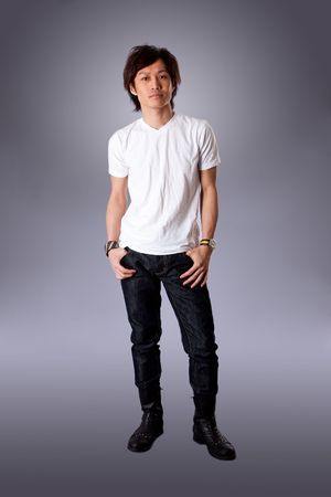 Casual Asian man wearing white shirt and jeans standing, isolated. Reklamní fotografie