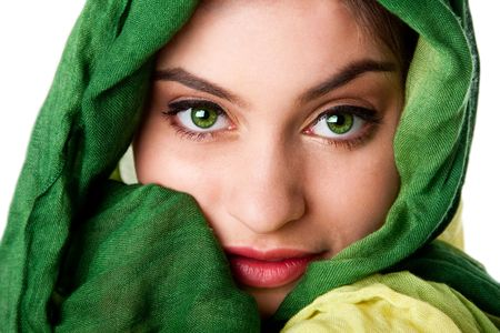 shy girl: Portrait of mysterious beautiful Caucasian Hispanic Latina woman face with green penetrating eyes and green fashion scarf wrapped around head, isolated.