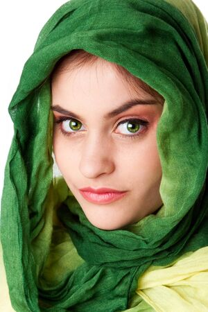 pakistani females: Portrait of mysterious beautiful Caucasian Hispanic Latina woman face with green penetrating eyes and green fashion scarf wrapped around head, isolated.