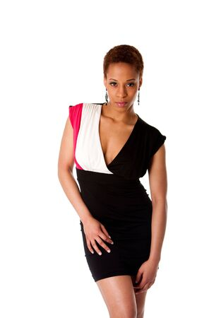 african business: Beautiful African American business woman wearing black fashion dress, isolated. Stock Photo