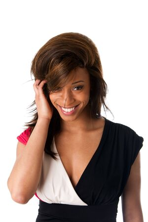 shy woman: Face of beautiful African American business woman with a smile and shy expression and hand in straight hair, isolated.