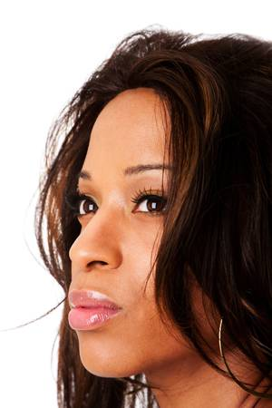 Face of a beautiful African American fashion business woman with natural makeup and long hair, isolated. photo
