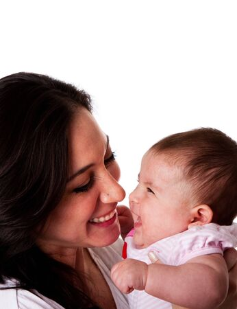 Faces of beautiful family couple of mother and daughter baby girl looking at eachother having fun and laughing, isolated.