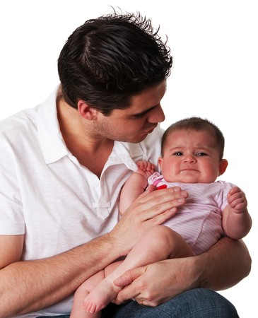 Handsome Caucasian Hispanic father trying to calm his cute unhappy crying baby daughter, isolated.