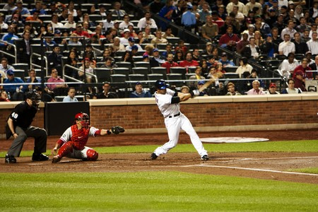 ruiz: New York, 27 May 2010: Angel Pagan striking batting a ball with Carlos Ruiz catching at Citi Field Park stadium in Queens, New York, as the baseball game of Mets vs. Phillies. Editorial