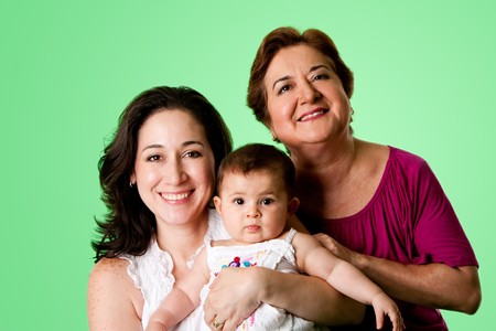 grandmother grandchild: Beautiful happy three 3 generations of Caucasian Hispanic Latina women, grandmother, mother and baby girl, on green.