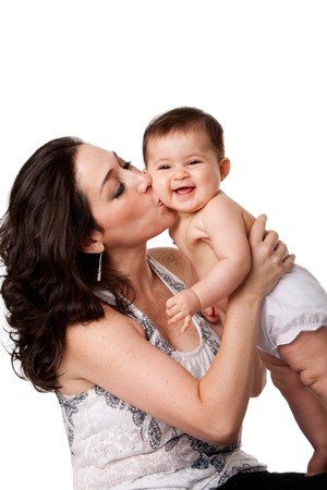 babies: Beautiful mother kissing happy smiling laughing baby on cheek, isolated.