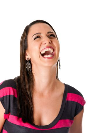 Beautiful woman laughing hysterically, isolated. photo