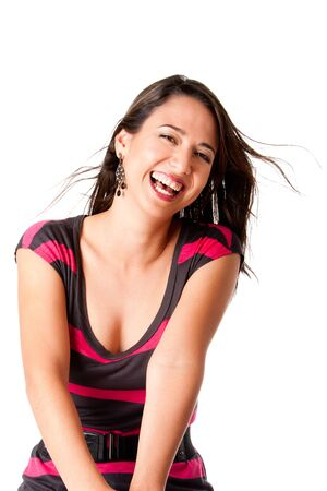 Beautiful laughing young woman with twirling brown hair having lots of fun, isolated. photo