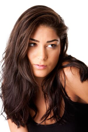 latina girl: Face of beautiful brunette woman looking to side with clean smooth skin and long brown hair, isolated.