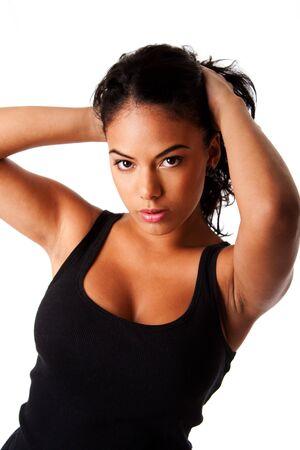 탱크 탑: Beautiful Hispanic woman with tanned skin holding pulling up long black hair wearing tank top, isolated.