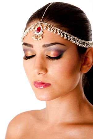 Beautiful face of a Middle Eastern woman with Arabic style makeup and head jewelry, typically used by Indian belly dancers, isolated. photo