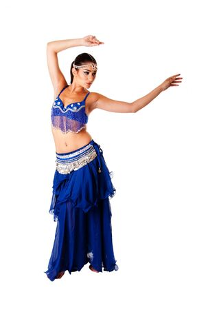 Beautiful Arabic belly dancer harem woman in blue with silver dress and head jewelry with gem dancing swirling her arms, isolated. photo