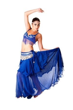 harem: Beautiful Arabic belly dancer harem woman in blue with silver dress and head jewelry with gem dancing holding skirt, isolated.