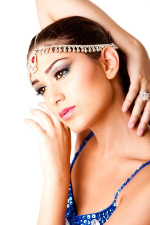 Face with hands of a beautiful Middle Eastern Egyptian Israeli Lebanese Turkish Arabic woman with makeup in the Belly Dancer style, isolated. photo