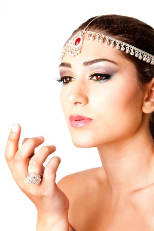 Hand in front of a beautiful Middle Eastern Egyptian Israeli Lebanese Turkish Arabic woman Face with makeup in the Belly Dancer style, isolated. photo