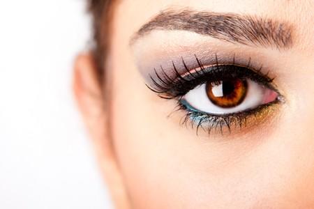 Fashion beautiful female brown watchful eye with long black eyelashes mascara, isolated. Stok Fotoğraf