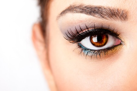 Fashion beautiful female brown watchful eye with long black eyelashes mascara, isolated. photo