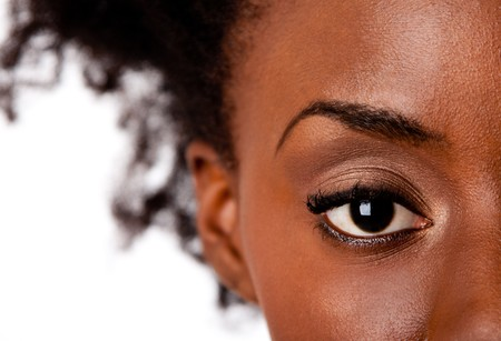 Fashion beautiful African American female brown watchful eye with black eyelashes mascara, isolated.