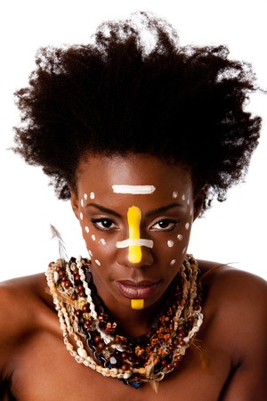 Beautiful head of an African tribal woman with Afro curly hair, face paint dots stripes,  bare shoulders and smooth brown skin wearing Earth-tone bead shell necklaces with feathers, isolated.