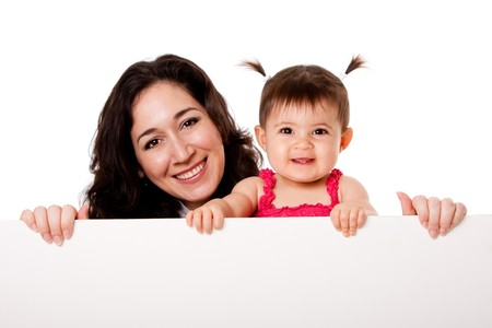 teething: Beautiful happy family mother and teething baby daughter holding white board, isolated.
