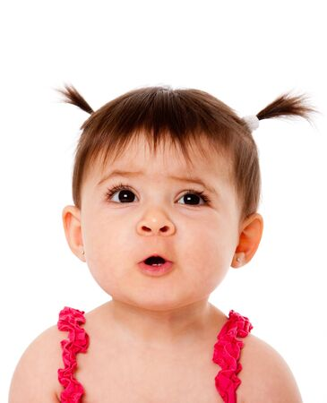 ponytails: Face of cute surprised baby infant girl with ponytails, making funny mouth expression, isolated.