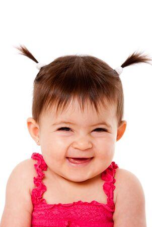 Gesicht des hübsch glücklich lachend Baby Kleinkind Mädchen mit Ponytails kichern lächelnd, isoliert.