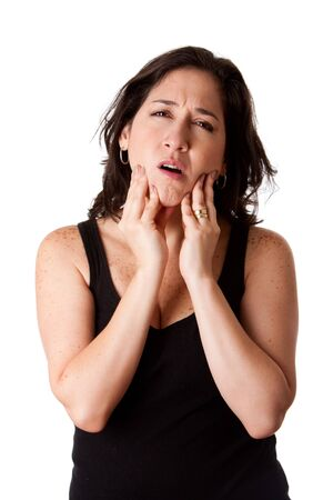 Beautiful young attractive woman with dental tooth jaw pain expression feeling unwell, holding her chin, isolated.
