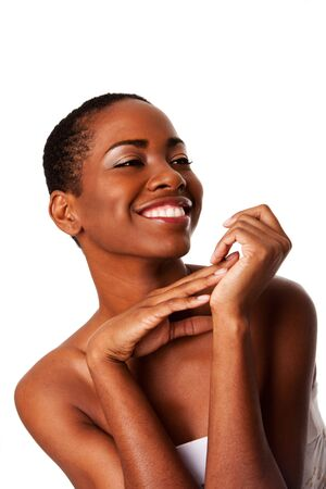 Beautiful happy smiling inspiring African woman with short curly hair and great skin showing teeth, isolated. Stock Photo - 8855477