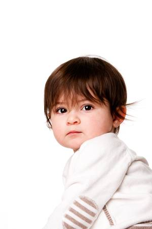 Face of a cute adorable baby infant toddler with innocent surprised expression looking over shoulder, isolated. 版權商用圖片
