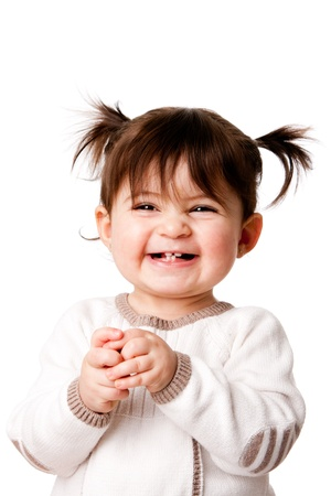 Beautiful expressive adorable happy cute laughing smiling baby infant toddler girl with ponytails showing teeth, isolated.