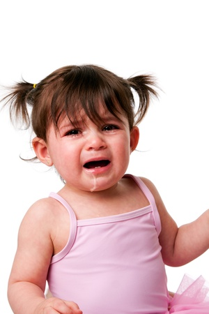 Face of a cute adorable baby infant toddler with cranky sad crying expression, isolated. Stock Photo - 8942740