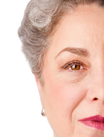 watchful: Beautiful watchful eye of a healthy senior woman with experience, isolated.
