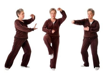 Beautiful Senior woman doing Tai Chi exercise to keep her joints flexible, isolated. Imagens - 9030615