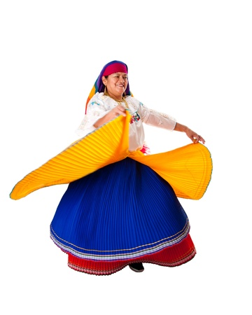 Beautiful senior Latin Gypsy woman from South America dressed in Folklore clothes from Ecuador, Colombia, Bolivia or Venezuela, dancing twirling around, isolated. photo