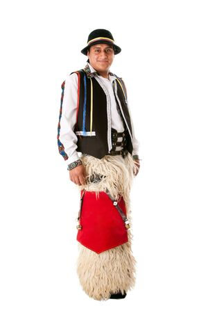 Happy Latino man from South America highland dressed in Folklore clothes with Llama fur from Ecuador, Peru or Bolivia, isolated.