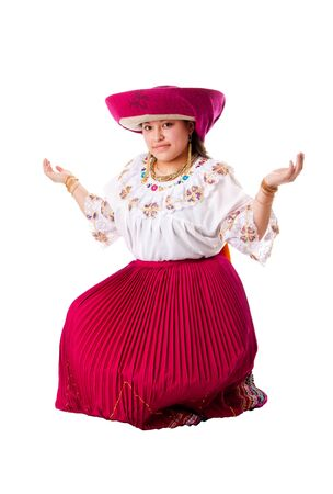 quechua: Beautiful happy Indian woman from Andes, Ecuador, Peru or Bolivia with folklore clothes and hat sitting, isolated. Stock Photo