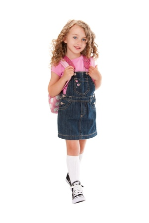 Happy preschooler with backpack walking to school in the spring or summer, isolated. Stock Photo