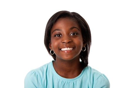 black woman face: Beautiful smiling face of a happy African teenager girl, isolated. Stock Photo