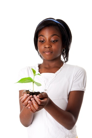 A young new plant growing from palm in hands of beautiful African girl, isolated. Drought on Earth concept.