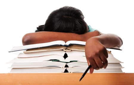 Student tired of doing homework studying with pen asleep on open books, isolated.