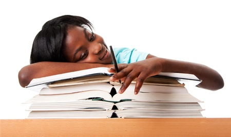 unmotiviert: Student tired of doing homework studying with pen laying unmotivated on stack open books, isolated.
