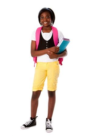 carrying girl: Beautiful happy student girl with colorful notebooks and backpack ready for school, isolated.