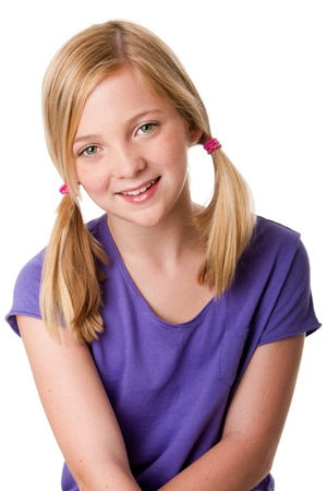 innocent: Beautiful cute happy teenager girl with pigtails, blond hair and freckles, isolated. Stock Photo