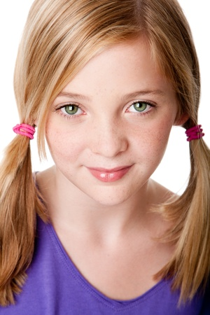 Beautiful cute sincere face of happy teenager girl with pigtails, blond hair, green eyes and freckles, isolated.